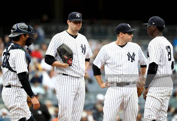 Jordan Montgomery of the New York Yankees reacts after loading up the bases as teammates Kyle HigashiokaChase Headley and Didi Gregorius come to the...