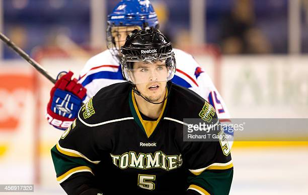Jordan Moore of the St. Thomas University Tommies skates against the Massachusetts Lowell River Hawks during NCAA exhibition hockey at the Tsongas...