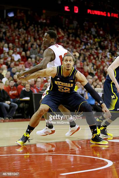 Jordan Morgan of the Michigan Wolverines boxes out for a rebound during the game against the Wisconsin Badgers at Kohl Center on January 18, 2014 in...