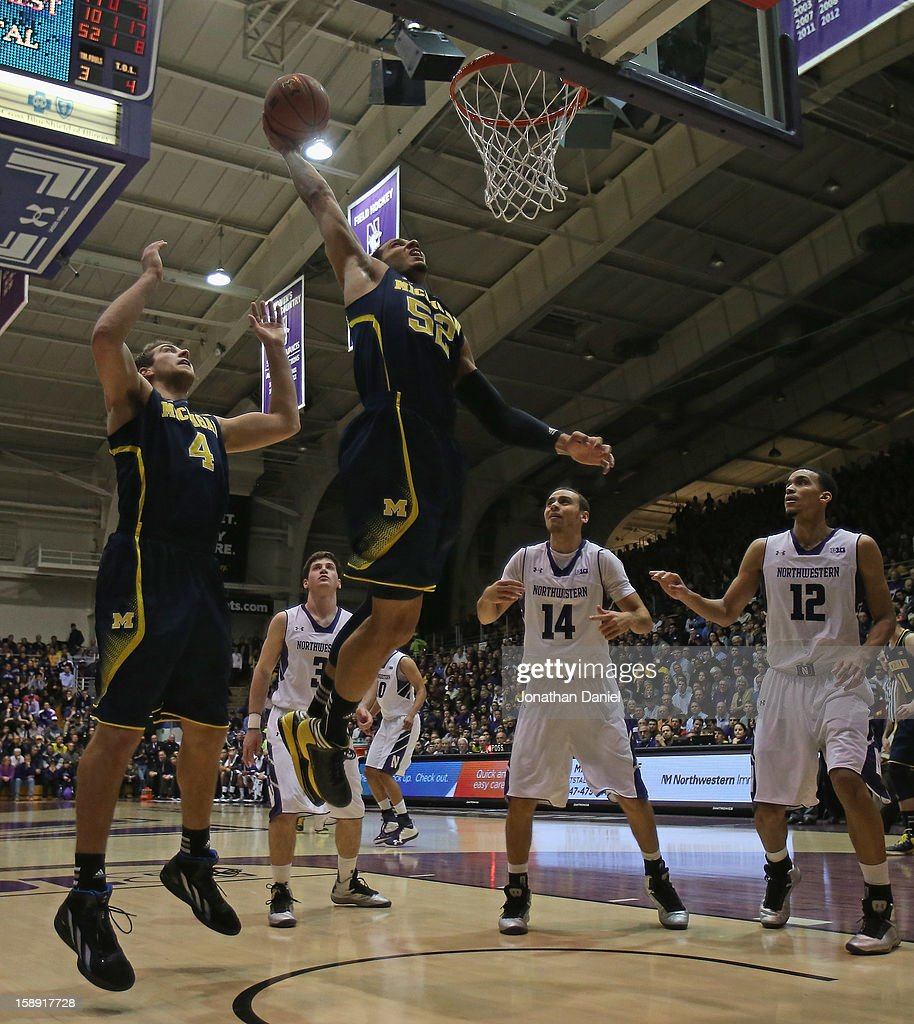 Jordan Morgan #52 of the Michigan Wolverines goes up for a dunk over teammate Mitch McGary #4 and Tre Demps #14 and Jared Swopshire #12 of the Northwestern Wildcats at Welsh-Ryan Arena on January 3, 2013 in Evanston, Illinois. Michigan defeated Northwestern 94-66.