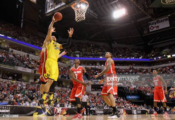 Jordan Morgan of the Michigan Wolverines goes up for a shot during the first half of the Big Ten Basketball Tournament Semifinal game against the...