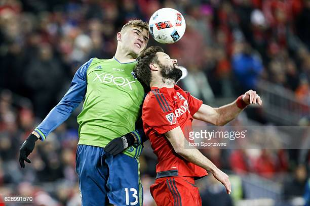 Jordan Morris of Seattle Sounders battles for the ball against Drew Moor of Toronto FC during the first half on December 10 at BMO Field in Toronto...