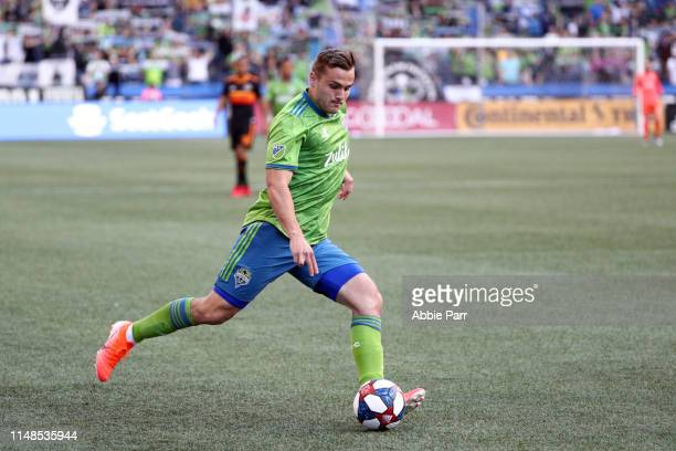 Jordan Morris of Seattle Sounders dribbles with the ball in the first half against the Houston Dynamo during their game at CenturyLink Field on May...