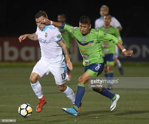 Jordan Morris of Seattle Sounders FC and Roberto Dominguez of Santa Tecla fight for the ball during the first leg match between Santa Tecla and...
