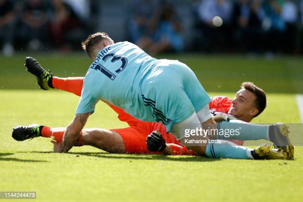 Jordan Morris of Seattle Sounders slides over Tyler Miller of Los Angeles FC after Morris' shot on goal during a game at Banc of California Stadium...