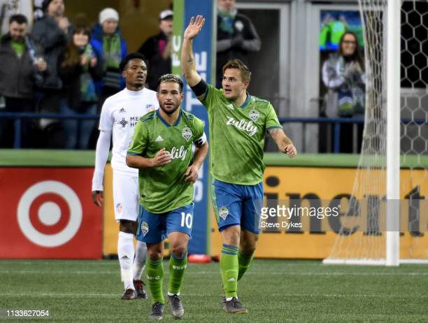 Jordan Morris of the Seattle Sounders acknowledges the crowd after scoring a goal as teammate Nicolas Lodeiro heads up the pitch during the first...