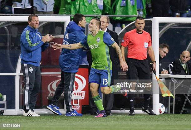 Jordan Morris of the Seattle Sounders celebrates scoring a goal with the Sounders bench during the first of of a match against the Colorado Rapids in...