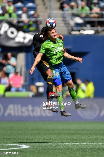 Jordan Morris of the Seattle Sounders heads the ball against Eddie Segura of the Los Angeles FC during the second half of the match at CenturyLink...