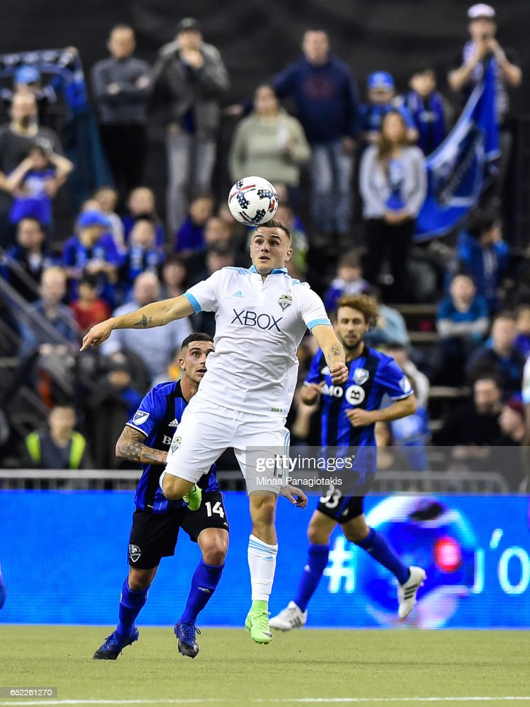 Jordan Morris #13 of the Seattle Sounders jumps for the ball during the MLS game against the Montreal Impact at Olympic Stadium on March 11, 2017 in Montreal, Quebec, Canada. The Seattle Sounders FC and the Montreal Impact end up in a 2-2 draw.