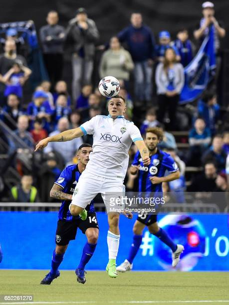 Jordan Morris of the Seattle Sounders jumps for the ball during the MLS game against the Montreal Impact at Olympic Stadium on March 11 2017 in...