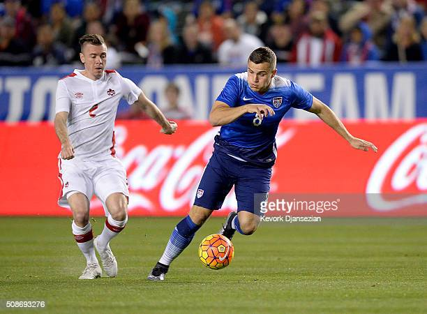 Jordan Morris of the United States breaks away from Nik Legerdwood of Canada during the first half of their international friendly soccer match at...