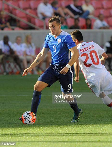 Jordan Morris of the United States directs the ball away from Dylan Carriero of Canada during the third place CONCACAF Olympic Qualifying match at...