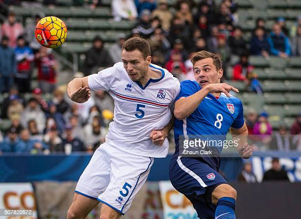Jordan Morris of the United States heads the ball towards goal as Jon Gudni Fjoluson of Iceland defends during the International Soccer Friendly...