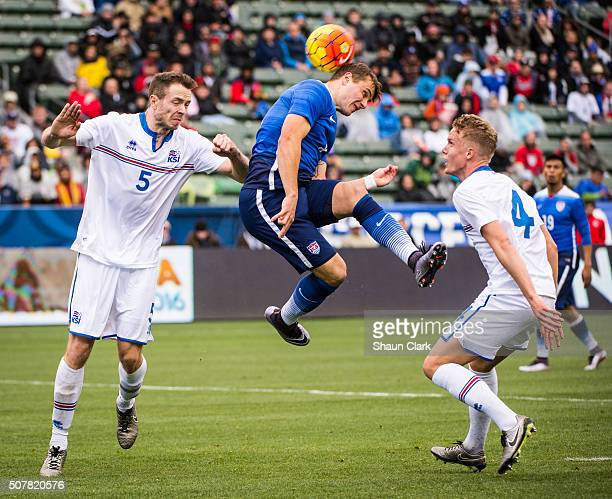 Jordan Morris of the United States heads the ball towards goal as Jon Gudni Fjoluson and Hjoerue Hermannsson of Iceland defend during the...