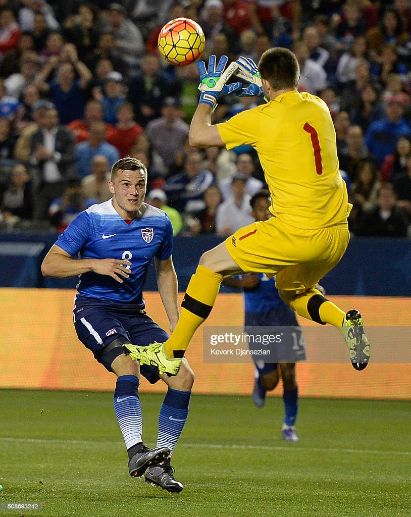 Jordan Morris #8 of the United States lifts the ball above goalkeeper Maxime Crepeau #1 of Canada as he attempts to score during the first half of their international friendly soccer match at StubHub Center February 5, 2016, in Carson, California.