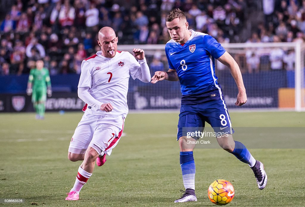 Jordan Morris #8 of the United States races in on goal as Iain Hume #7 of Canada defends during the International Soccer Friendly match between the United States and Canada at the StubHub Center on February 5, 2016 in Carson, California. The United States won the match 1-0