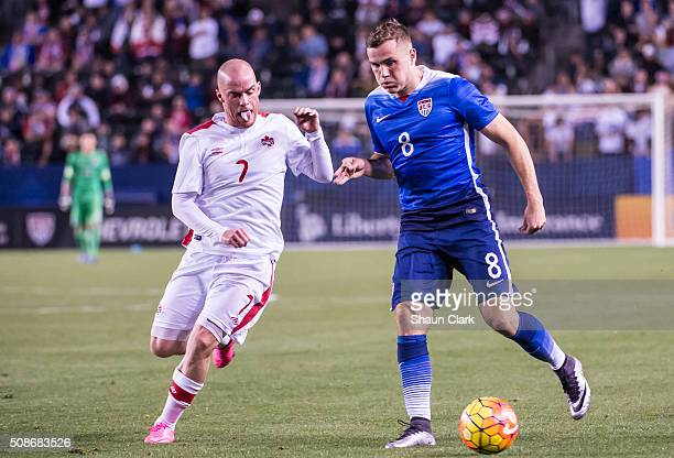 Jordan Morris of the United States races in on goal as Iain Hume of Canada defends during the International Soccer Friendly match between the United...