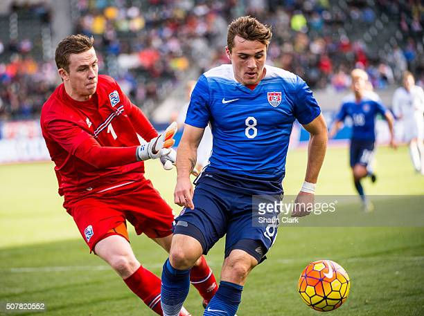 Jordan Morris of the United States races into the penalty box as Ogmundur Kristinsson of Iceland defends during the International Soccer Friendly...