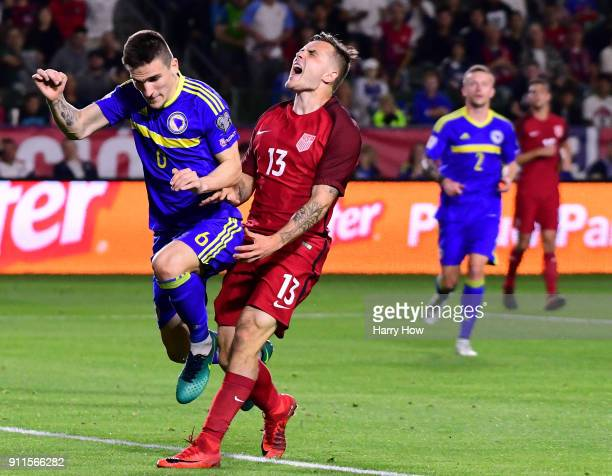 Jordan Morris of The United States reacts to his missed chance behind Daniel Graovac of Bosnia Herzegovina during a 00 draw at StubHub Center on...