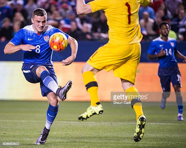 Jordan Morris of the United States tries to chip the ball over Maxime Crépeau of Canada during the International Soccer Friendly match between the...