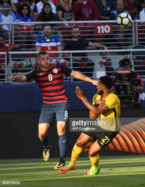 Jordan Morris of the USA heads the ball over Jermaine Taylor of Jamaica during the final football game of the 2017 CONCACAF Gold Cup at the Levi's...