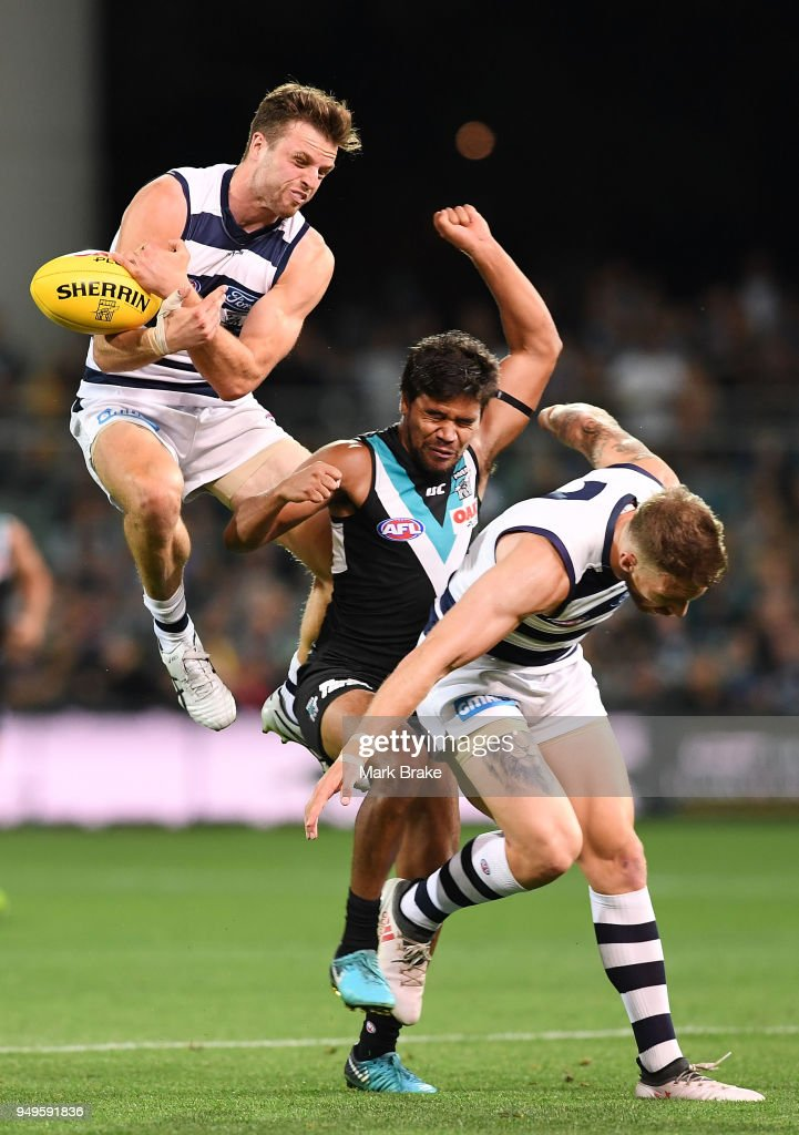 Jordan Murdoch of the Cats attempts to mark over Jake Neade of Port Adelaide during the round five AFL match between the Port Adelaide Power and the Geelong Cats at Adelaide Oval on April 21, 2018 in Adelaide, Australia.