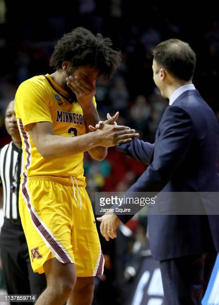 Jordan Murphy and head coach Richard Pitino of the Minnesota Golden Gophers react against the Michigan State Spartans during the second half in the...