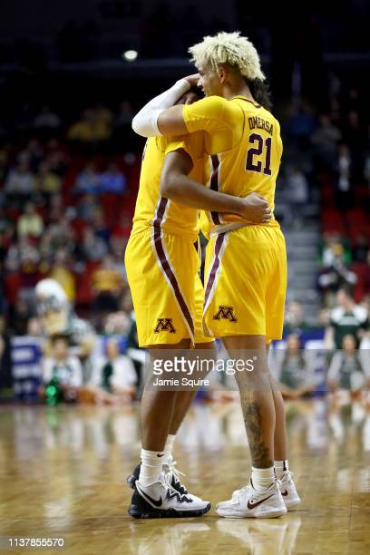Jordan Murphy and Jarvis Omersa of the Minnesota Golden Gophers react against the Michigan State Spartans during the second half in the second round...