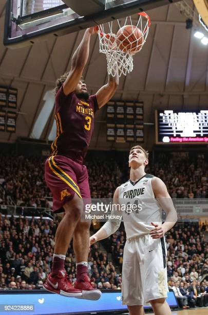 Jordan Murphy of the Minnesota Golden Gophers dunks the ball against Isaac Haas of the Purdue Boilermaker at Mackey Arena on February 25 2018 in West...