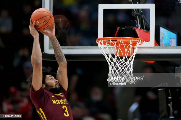 Jordan Murphy of the Minnesota Golden Gophers dunks the ball in the first half against the Purdue Boilermakers during the quarterfinals of the Big...