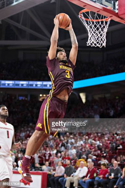 Jordan Murphy of the Minnesota Golden Gophers goes up for a dunk during a game against the Arkansas Razorbacks at Bud Walton Arena on December 9,...