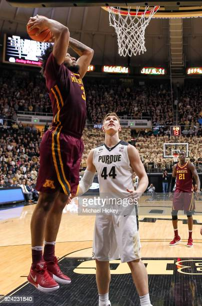 Jordan Murphy of the Minnesota Golden Gophers goes up for the dunk against Isaac Haas of the Purdue Boilermakers at Mackey Arena on February 25 2018...