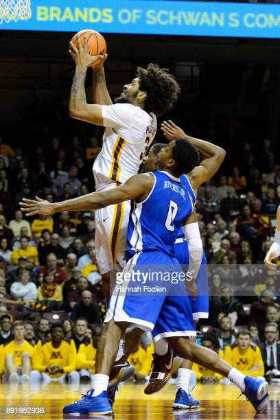 Jordan Murphy of the Minnesota Golden Gophers shoots the ball against CJ Rivers of the Drake Bulldogs during the game on December 11 2017 at Williams...