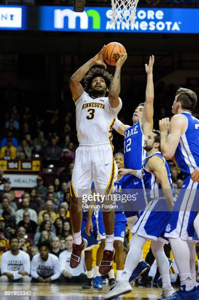 Jordan Murphy of the Minnesota Golden Gophers shoots the ball against the Drake Bulldogs during the game on December 11 2017 at Williams Arena in...