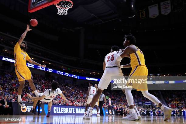 Jordan Murphy of the Minnesota Golden Gophers throws up a shot against Jordan Nwora of the Louisville Cardinals during their game in the First Round...