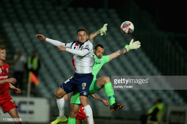 Jordan Murray of Central Coast contests the ball against Isaac Richards of Adelaide United during the FFA Cup 2019 Semi Final between the Central...