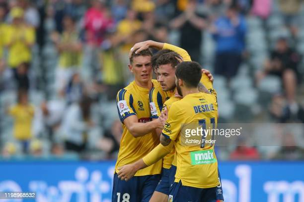 Jordan Murray of the Central Coast Mariners celebrates his goal with team mates during the round 14 ALeague match between the Central Coast Mariners...