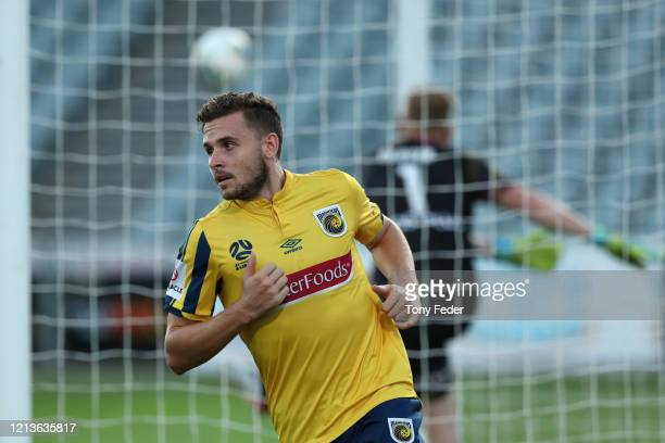 Jordan Murray of the Central Coast Mariners scores a goal during the round 24 ALeague match between the Central Coast Mariners and Melbourne City at...