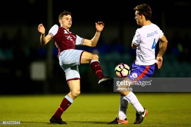 Jordan Murray of the Tigers contests the ball with Travis Oughtred of Manly United FC during the NSW NPL Men's match between APIA Leichhardt Tigers...