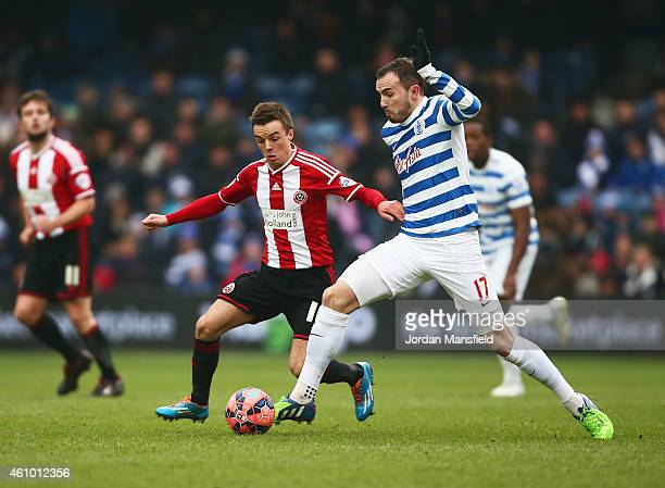 Jordan Mutch of QPR battles with Stefan Scougall of Sheffield United during the FA Cup Third Round match between Queens Park Rangers and Sheffield...