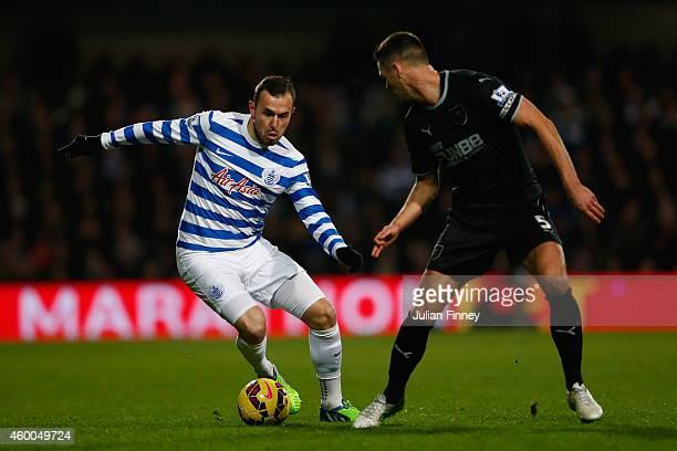 Jordan Mutch of QPR evades Jason Shackell of Burnley during the Barclays Premier League match between Queens Park Rangers and Burnley at Loftus Road...