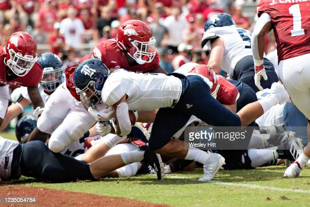 Jordan Myers of the Rice Owls runs the ball in for a touchdown in the first half of a game against the Arkansas Razorbacks at Donald W. Reynolds...