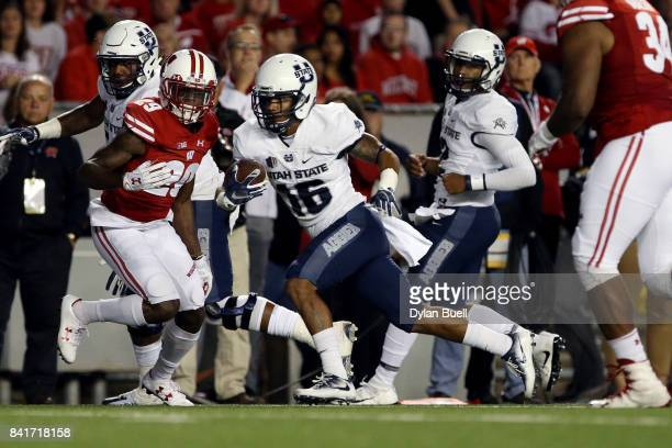 Jordan Nathan of the Utah State Aggies runs with the ball in the first quarter against the Wisconsin Badgers at Camp Randall Stadium on September 1...