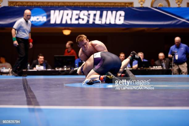 Jordan Newman of WisconsinWhitewater wrestles Tyler Lutes of Wartburg in the 184 weight class during the Division III Men's Wrestling Championship...