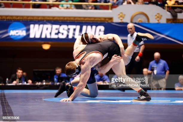 Jordan Newman, of Wisconsin-Whitewater, wrestles Tyler Lutes, of Wartburg, in the 184 weight class during the Division III Men's Wrestling...