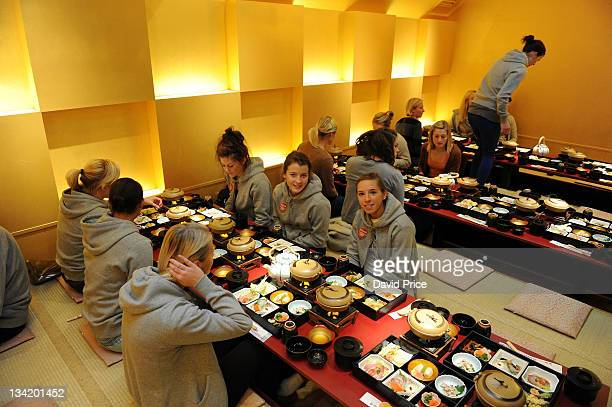 Jordan Nobbs and Angharad James of Arsenal Ladies FC players eat in a restaurant while visiting Kyoto during their tour to Japan on November 28 2011...