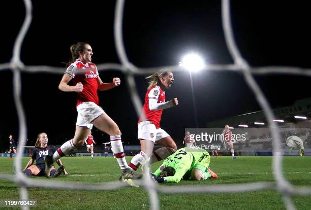 Jordan Nobbs and Louise Quinn of Arsenal celebrate their sides first goal during the FA Women's Continental League Cup Quarter Final match between...