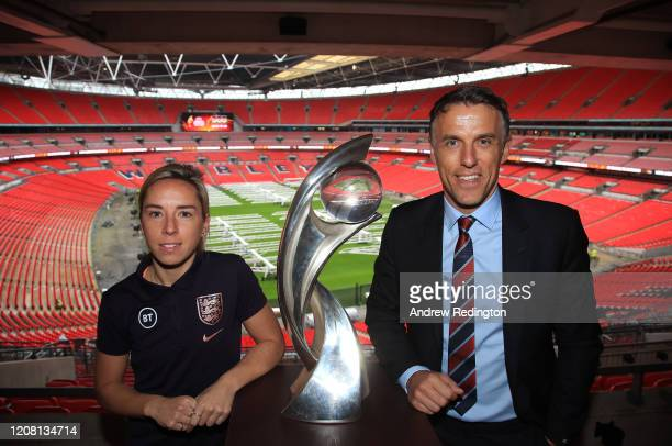 Jordan Nobbs and Phil Neville are pictured with the Championship trophy during the UEFA Women's EURO 2021 500 Days To Go Media Event at Wembley...