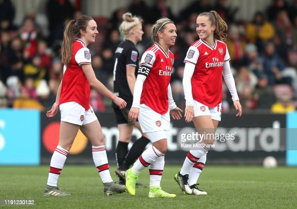 Jordan Nobbs of Arsenal celebrates with Lisa Evans and Lia Walti after scoring her sides seventh goal during the Barclays FA Women's Super League...