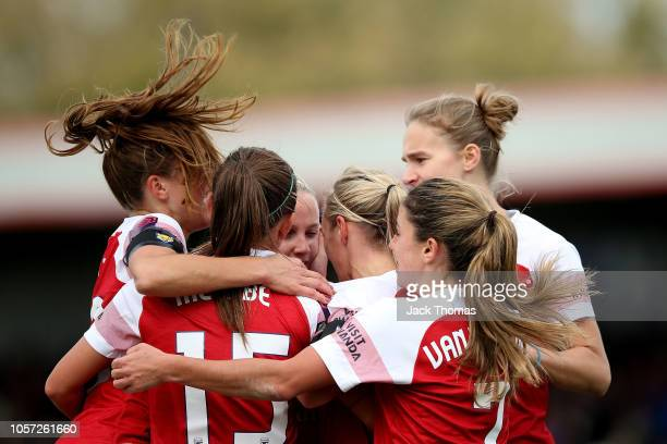 Jordan Nobbs of Arsenal celebrates with team mates after scoring her sides first goal during the WSL match between Arsenal Women and Birmingham...